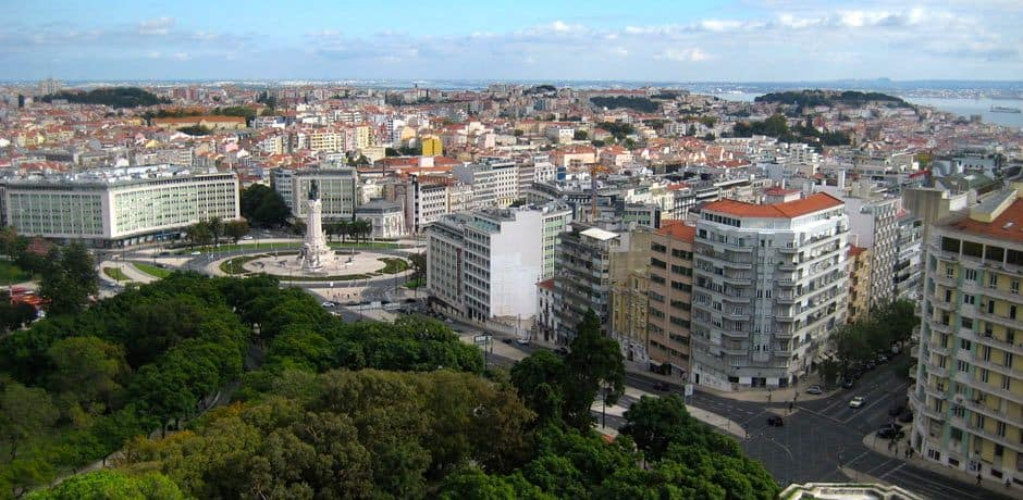 Pombal Square, and the city beyond, as seen from Lisbon's top hotel, the Four Seasons Ritz. The square is named for the Marquis of Pombal, who rebuilt Lisbon after its 1755 earthquake, complete with a few Parisian-style boulevards.