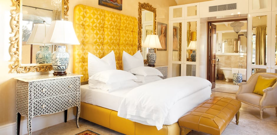 A colorful bedroom at Liz Biden's masterpiece La Residence in South Africa.