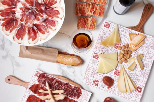 No visit to Mercado Little Spain in Manhattan's new Hudson Yards complex is complete without some jamón y queso (Serrano ham and Manchego cheese). Photo courtesy of Mercado Little Spain.