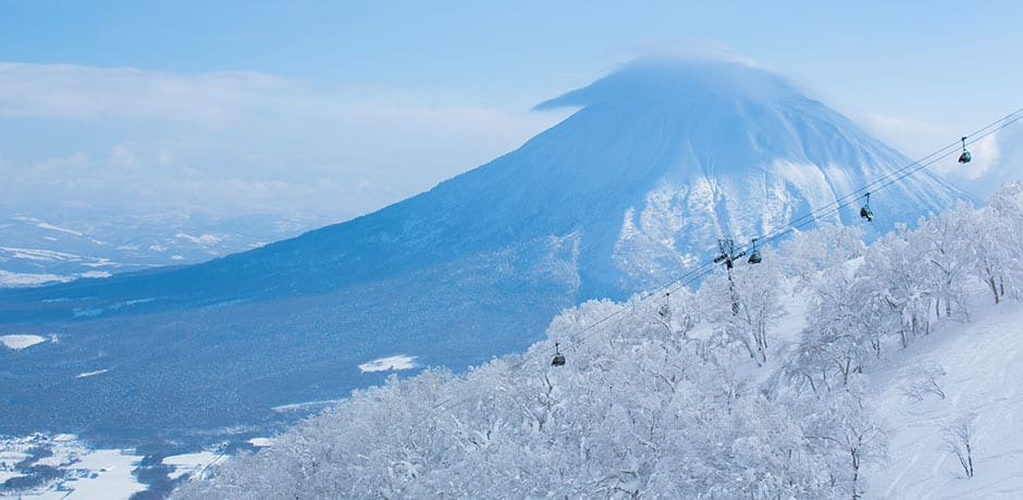 A chairlift with Mount Yotei in the background in Niseko. Photo by Niseko United