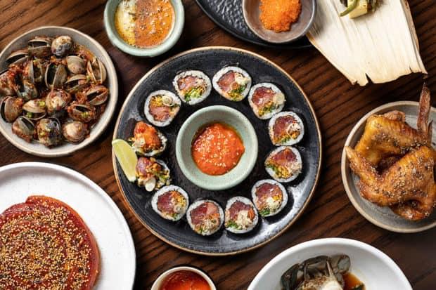 Spicy yellowfin tuna kimbap and shared plates at Kāwi, photo by Andrew Bezek