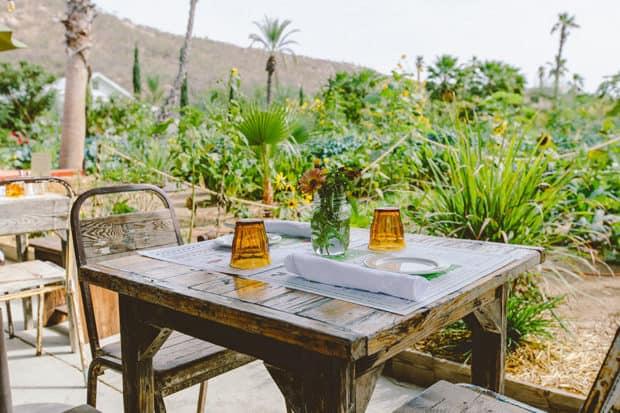 A table overlooking the garden at Flora Farms