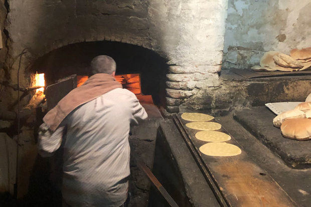 A local making man'oushe, a Lebanese breakfast bread