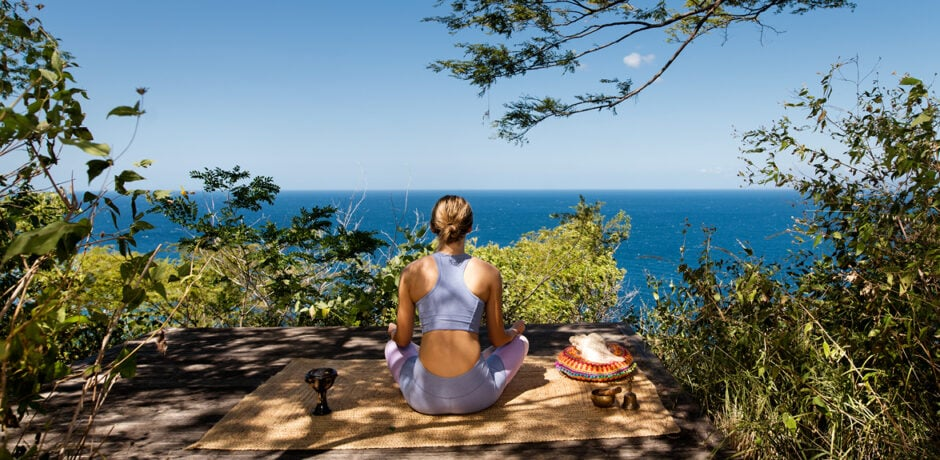 While we still might not be able to travel to our favorite wellness and yoga retreats—like Kasiiya Papagayo in Costa Rica, pictured here—you can incorporate these tips into your life at home for a healthier and more mindful summer lifestyle. Photo by Brooke Day