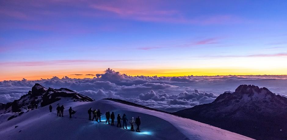 Summiting Mount Kilimanjaro at sunrise.
