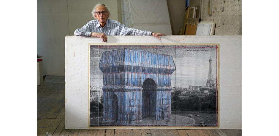 Christo in his studio with a preparatory drawing for