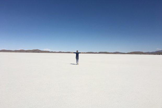Elise Bronzo of Indagare standing alone in Bolivian salt flats