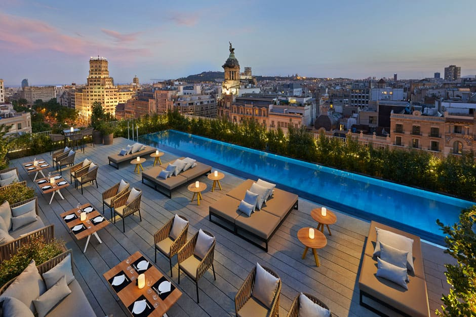 Outdoor pool area at dusk Mandarin Oriental Barcelona, Barcelona, Spain