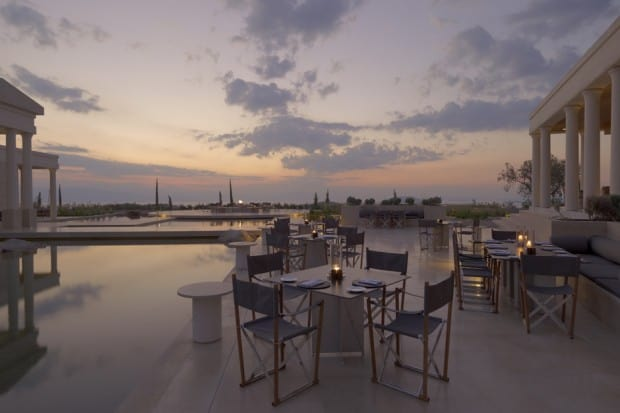 Outdoor dining area at sunset at Amanzoe in Greece