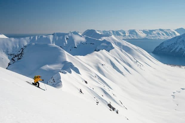 Downhill snow skiier on an empty mountain in Iceland