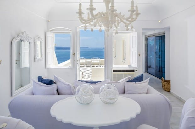 White living area with ocean view of Canaves Oia (Suites) in Santorini, Greece