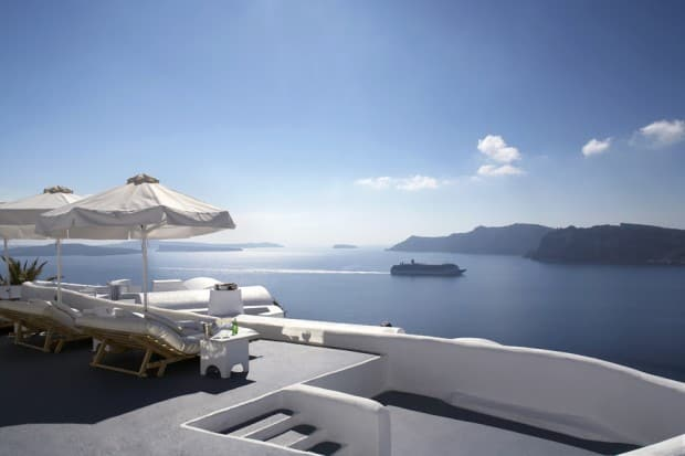 Beachfront patio with lounge chairs at Katikies hotel on Santorini, Greece
