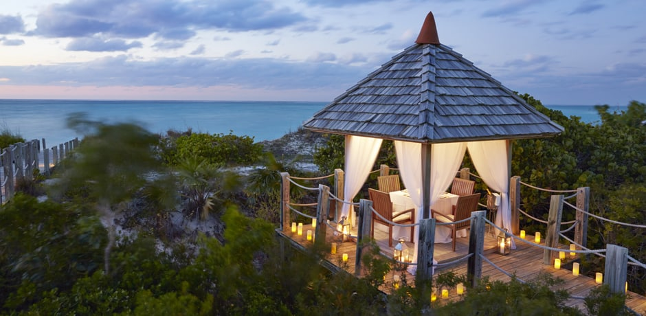 With luxury villas and gorgeous classic resorts, the Turks & Caicos is one of the Caribbean's most appealing destinations. Parrot Cay by COMO, located on its own private island, is exclusive and romantic—a place where luxury is all about pampering, wellness and staying put. Image Courtesy Parrot Cay.