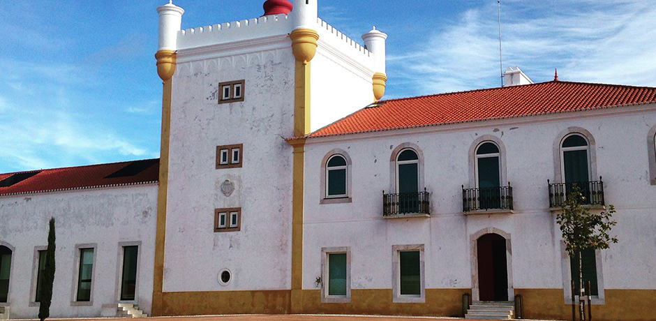 White-washed buildings outlined with a gold or royal blue strip distinguish the architecture in Alentejo. Shown is the main house of Torre de Palma, a converted wine estate dating back to the 14th century.