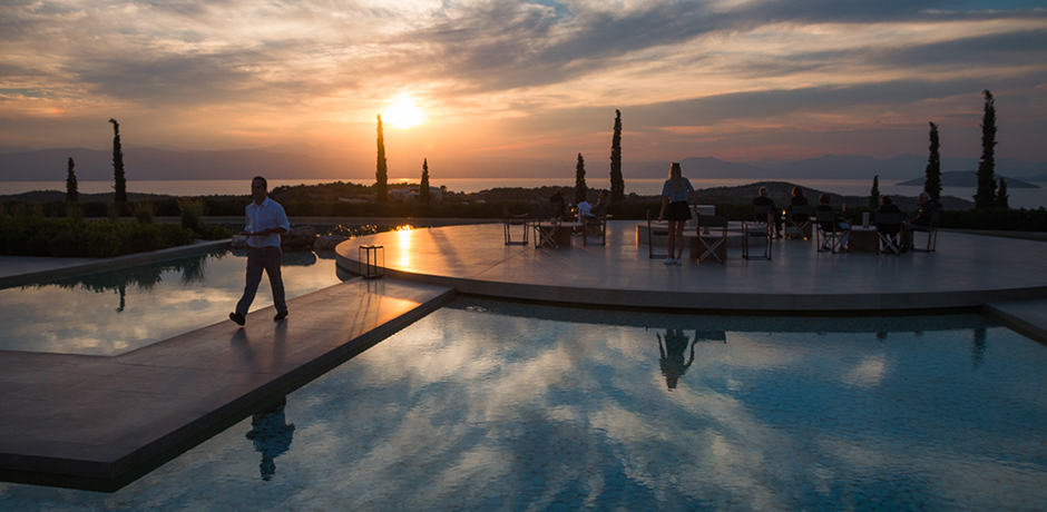 The fire pit is turned on at Amanzoe after the sun sets and the winds start to blow