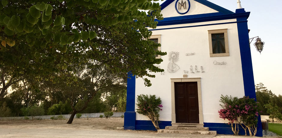 Like this church, all buildings in Comporta are painted in a strict blue and white palette