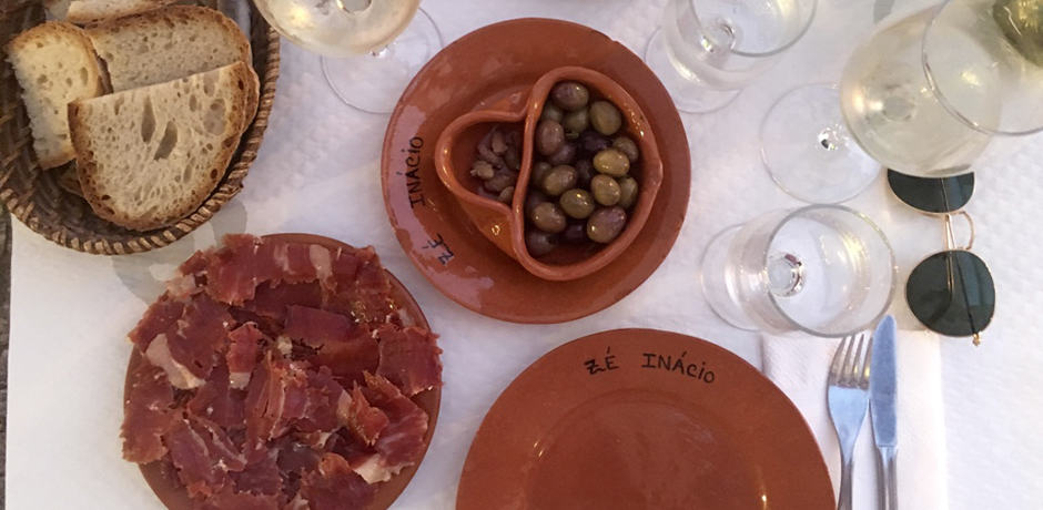 Almost all restaurants will bring you a plate of olives and bread and add it to the bill in the end; if you don't want it, you can ask them to take it back or just leave it untouched