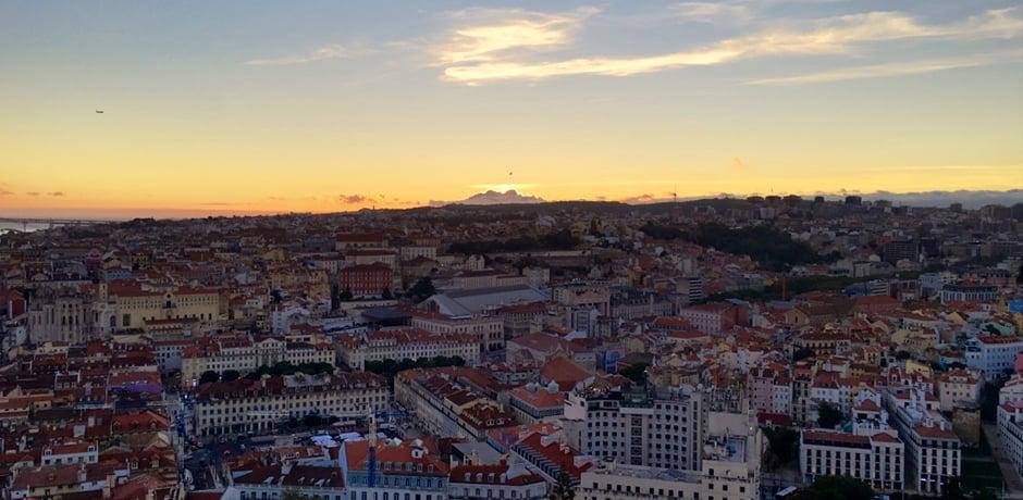 The sun sets over Lisbon, as seen from the hilltop São Jorge Castle
