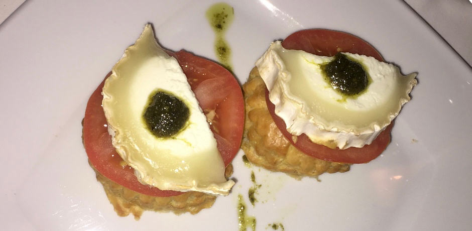 Perhaps Santorini's most romantic restaurant, Ambrosia occupies a beautiful terrace in Oia and serves upscale cuisine (like caramelized onion tart with goat cheese, pictured here).
