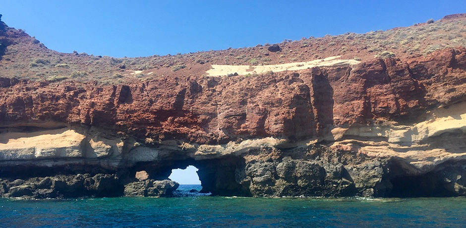 Exploring the caldera by boat is a must-do in Santorini.