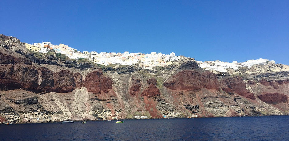 Looking up at Oia from the water.