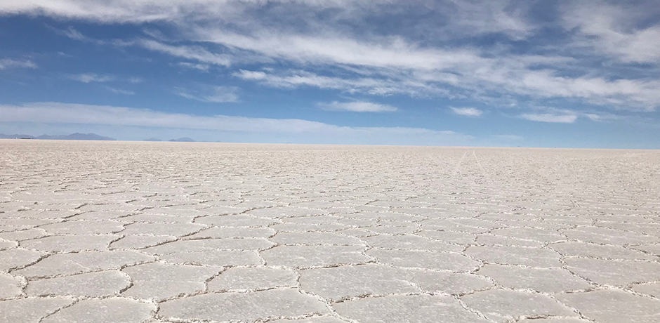 The vast Salar de Uyuni, the largest salt flats in the world, extends—quite literally—as far as the eye can see.