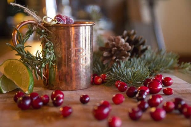 Yule Mule drink in copper mug with cranberries from Ranch at Rock Creek, Montana