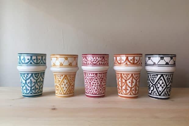 Five colorfully patterned ceramic cups at Chabi Chic in Marrakech