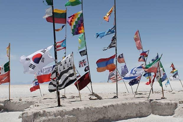 National flags at the Salar de Uyuni in Bolivia