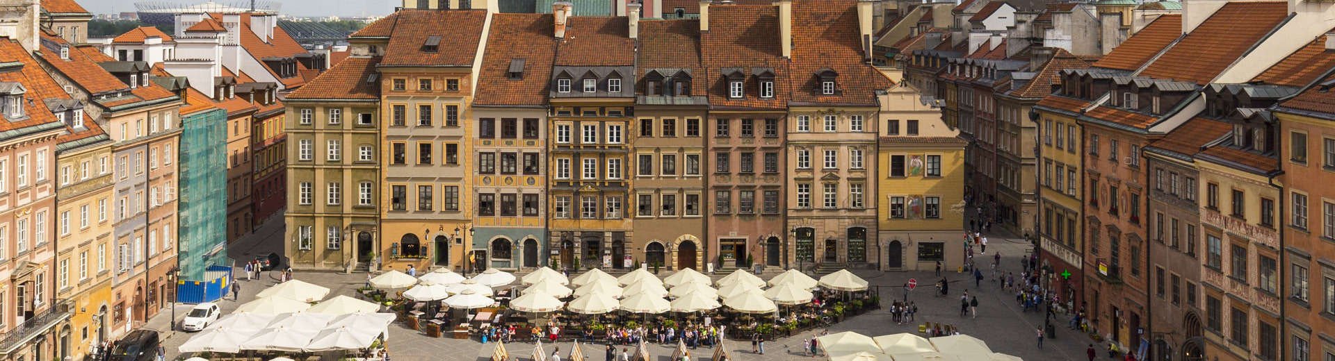 Warsaw's Old Town with tables and chairs outside
